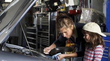 Auto mechanic fixing vehicle