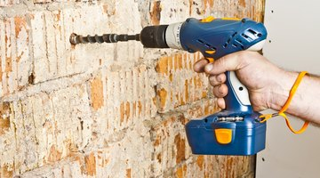 Drilling a hole into a brick wall