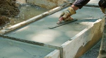 A finishing trowel gives a concrete slab a smooth surface.