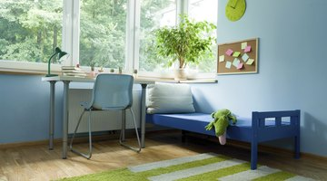 A calm child's room with blue and green accents.