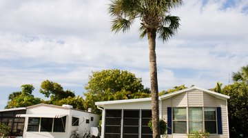 Two typical Florida mobile homes with screened in patio areas