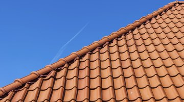 If you have a terracotta tile roof green is a good choice for a trim color.