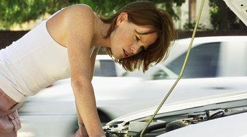 Man holding green fuel pump nozzle