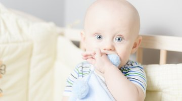 a caucasian baby begins to cry loudly