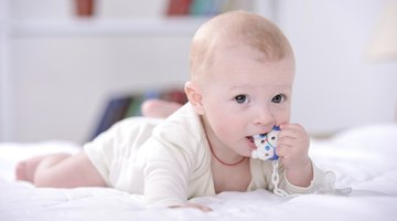 A baby with fingers in mouth