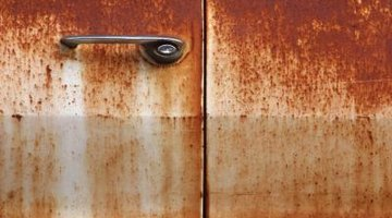Rust and discolouration are two effects of acid rain on automotives.