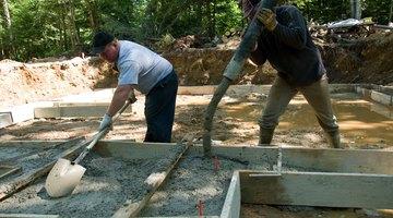 Construction workers pouring concrete.