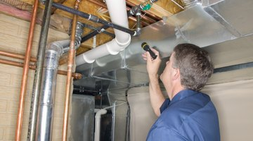 Inspecting pipes in a home.