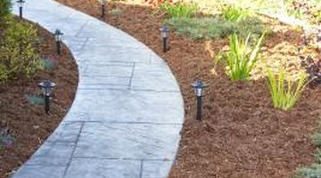 Mulch blocks light and water from reaching weed seeds.