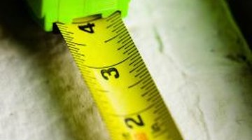Measure the length and width of the area where you want the concrete slab to be poured.