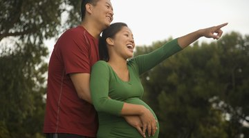 Cropped pregnant woman touching belly