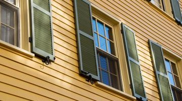 Cape Cod homes have regularly spaced, uniform windows with shutters.