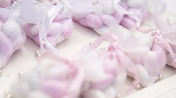 Wedding favours wrapped in tulle with pearl decorations.