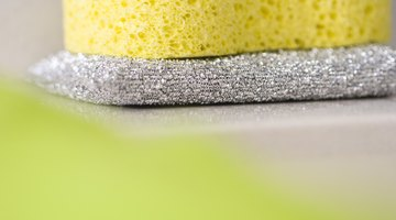 Use a scouring pad to wear off rust stain buildup.