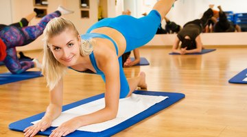 Athlete woman doing abdominal crunches exercise Side view concept fitness