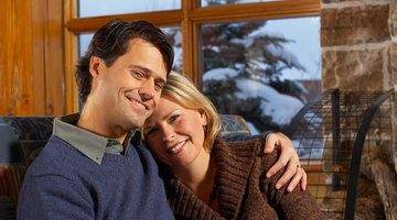Couple inside winter cabin