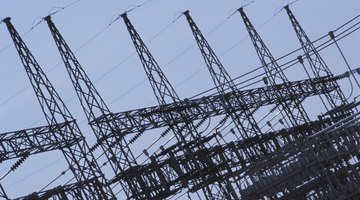 Two rows of electrical transmission lines and towers