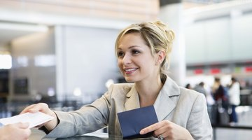 Woman checking in at airport ticket counter for standby flight