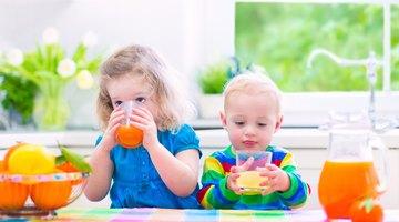 Kid eating orange