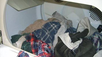 Load clothes into the dryer