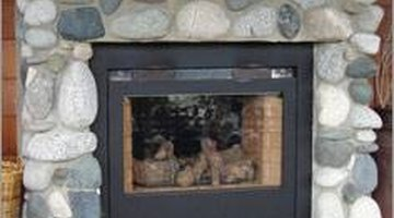 Installing river rock to your fireplace surround is a moderately simple do-it-yourself project.