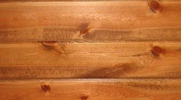 Knotty pine paneling stained