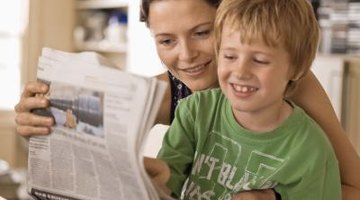 Mother and son reading paper