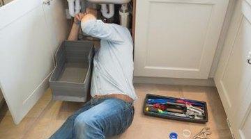 Man fixing sink pipe