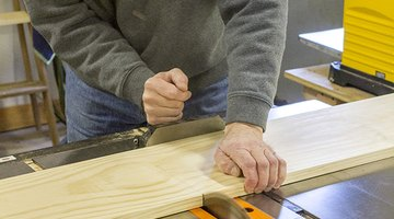 Use a saw to cut your wood board into individual shelves.