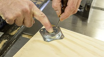 Mark where holes need to be drilled for the feet of the shelf.