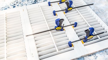 Using wood clamps, attach the four shutters together with wood glue and wood screws