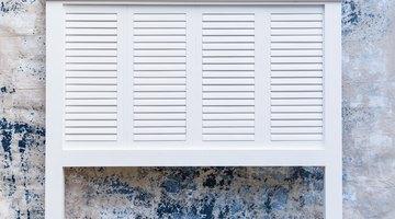 Reclaimed shutter headboard finished in white