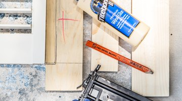 Wood glue and a brad nailer are used to secure each layer of the shutter headboard