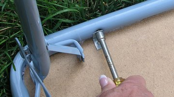 Remove the screws from the table frame.