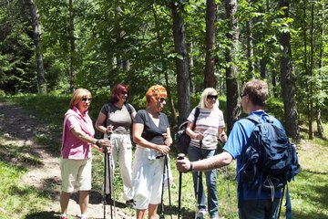 Activities Director leading group hike of four women