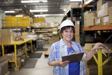 warehouse manager checking safety codes
