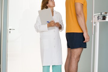 A man's height is measured in a medical center.