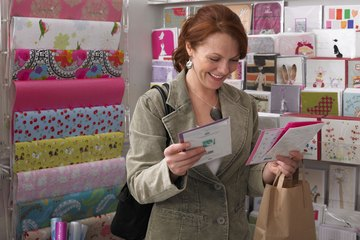 Woman browsing through greeting cards