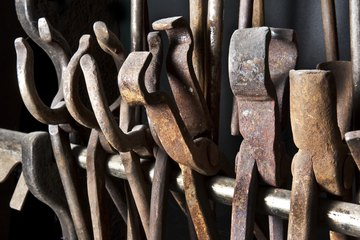 Variety of metal tongs in blacksmith forge