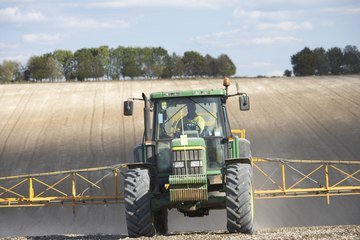Image of a tractor spraying a field.