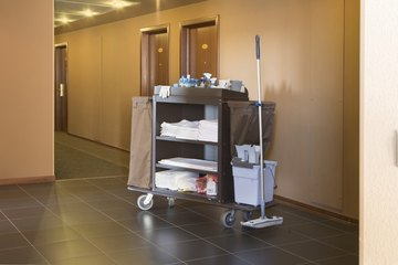 Hotel hallway with cleaning cart.