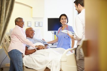 Image of a medical team and patient in hospital setting.
