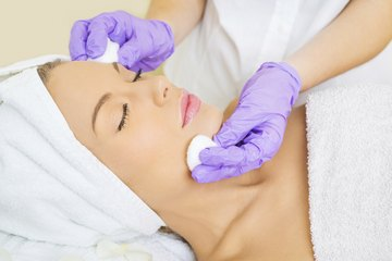 Woman receiving skin-care treatment
