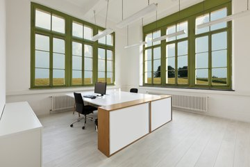 Large double workspace desk in office