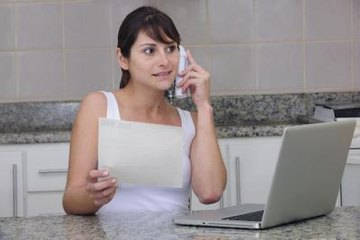 Woman on phone with customer service agent
