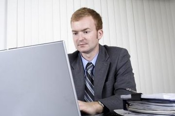 bank manager on computer