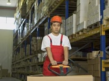 Pallet jacks are used by workers in warehouses to move freight.