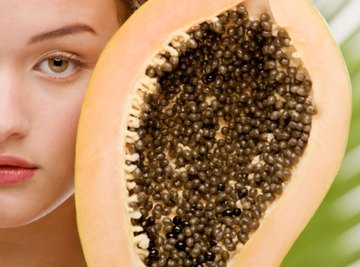 Seeds are located in a plant's fruit, while spores are under leaves.