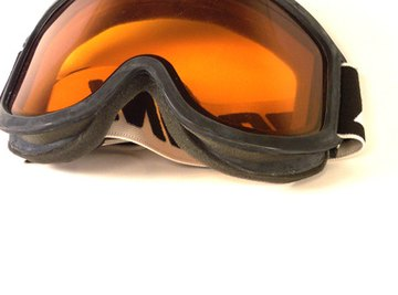 Wearing safety goggles when working with sodium carbonate prevents eye irritation.