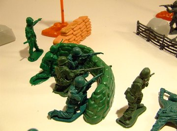 Use toy army figures to enhance the battlefield scene.
